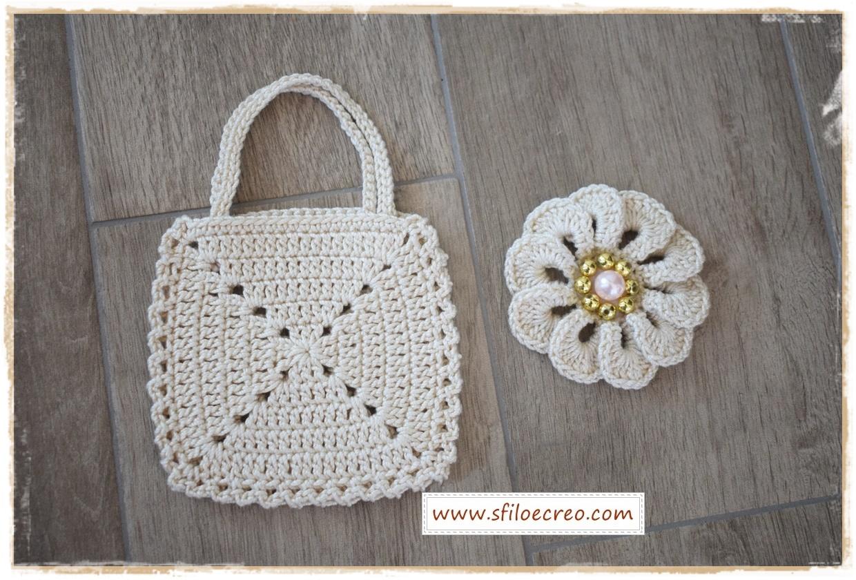 borsetta portaconfetti a uncinetto con fiore